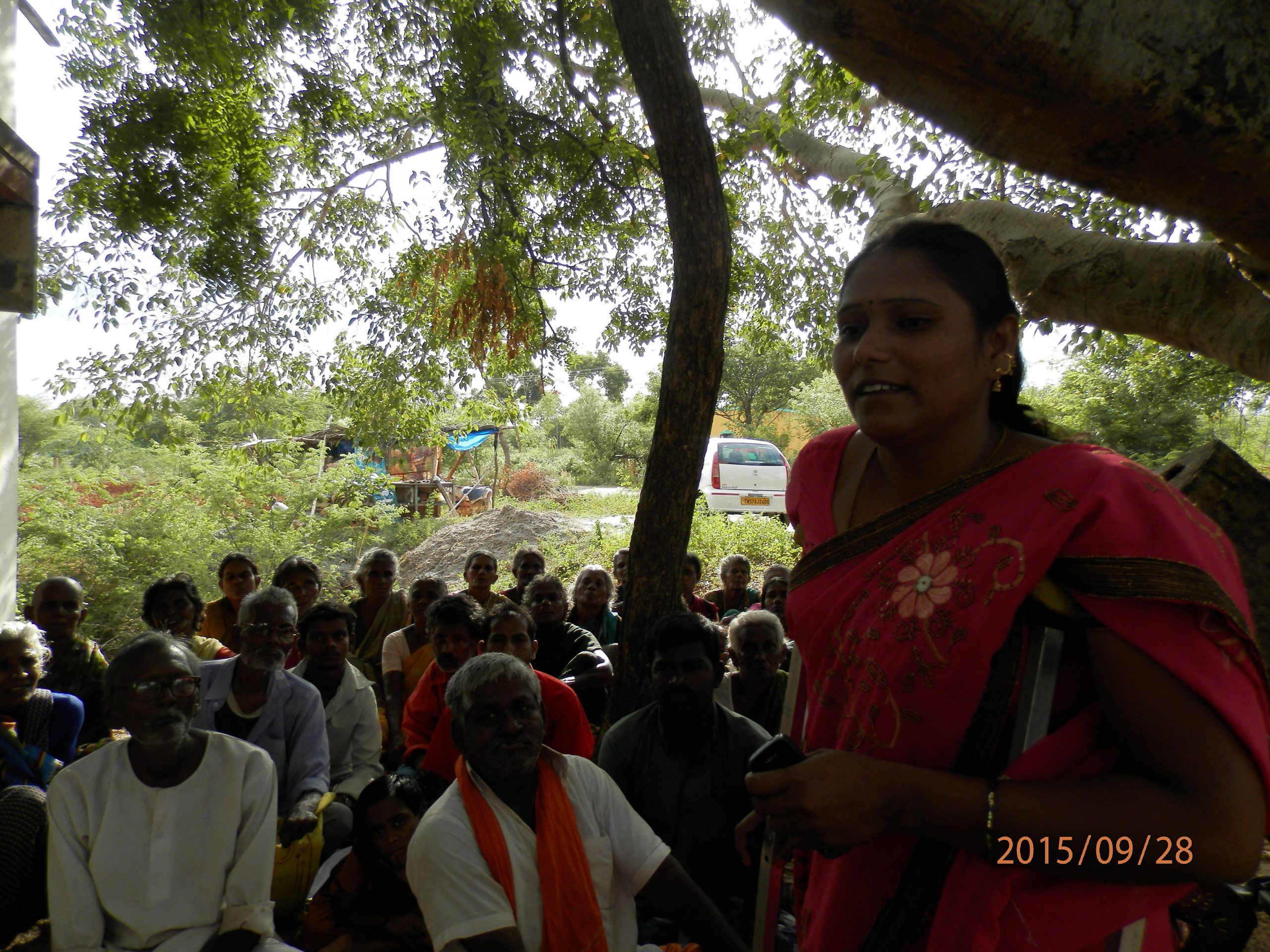 Neelavathi organizing a community meeting
